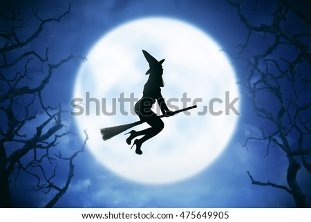 Silhouette of witch woman flying on the sky, with moonlight background. Halloween concept image