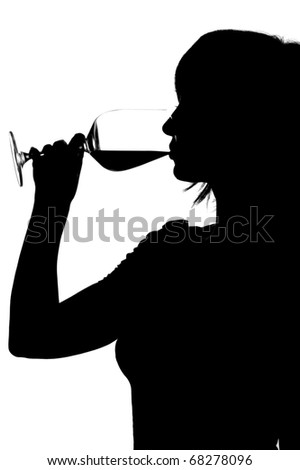 Silhouette of woman drinking red wine isolated on white - stock photo