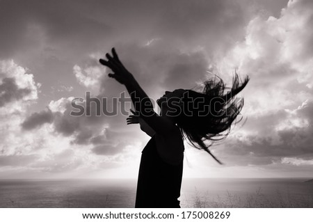 Silhouette of woman enjoying nature. Enjoyment. Freedom concept. - stock photo