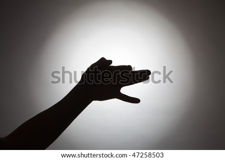 Silhouette of woman hands in form of a dog