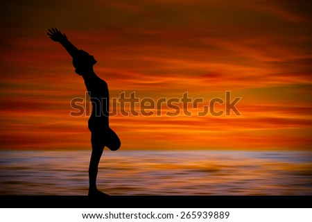Silhouette of woman making yoga poses on the beach - stock photo