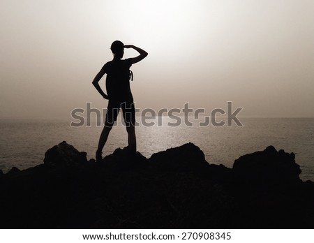 Silhouette of woman on a top of mountain. Tenerife, Canary Islands, Spain