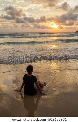 silhouette of woman relax on the beach.