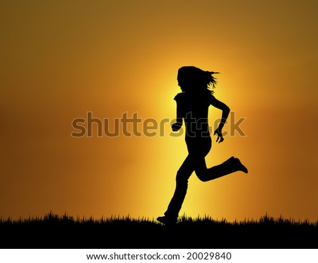 silhouette of woman running at sunset/sunrise