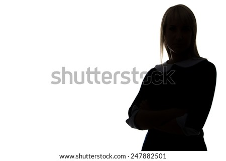 Silhouette of woman with arms crossed on white background, half-turned - stock photo