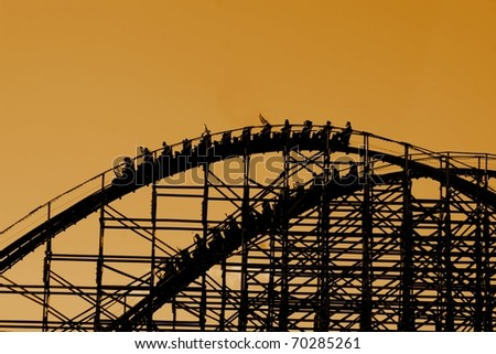Silhouette of wooden roller coaster - stock photo