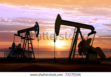 silhouette of working oil pumps on sunset background - stock photo