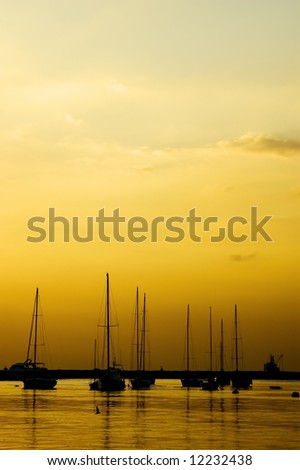 Silhouette of Yachts docked in Manila Bay, Philippines - stock photo