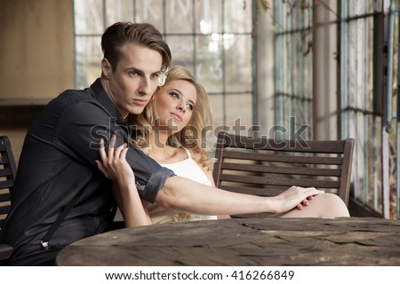 Silhouette of young adult couple in love posing in classic elegance dress to date