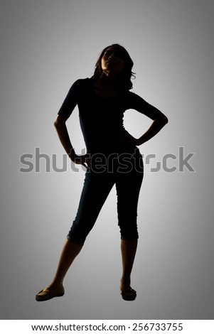 Silhouette of young Asian woman pose, full length portrait isolated. - stock photo