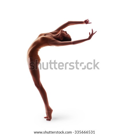 silhouette of young beautiful dancer in beige swimsuit isolated on white studio background