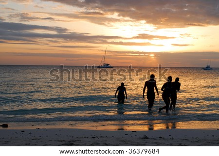 Silhouette of young couples at the sunset