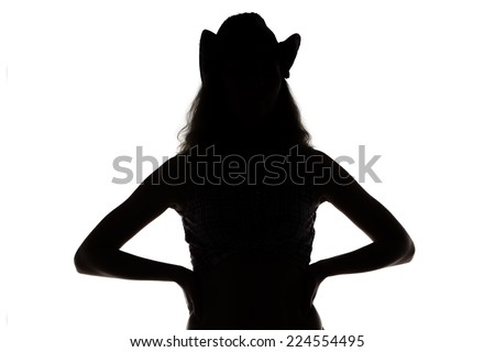 Silhouette of young cowgirl on white background - stock photo