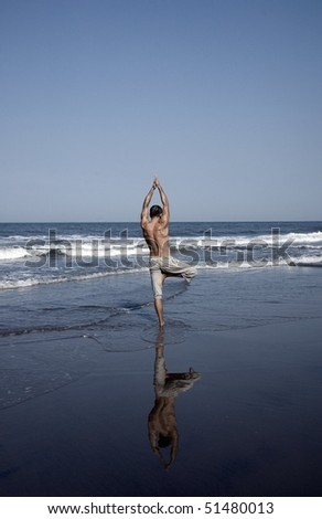silhouette of young man on yoga class at the beach, Goa, India, Asia - stock photo