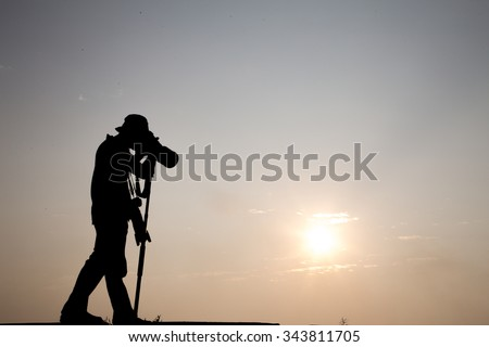 Silhouette of young photographer