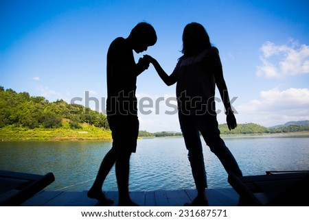 Silhouette of Young Romantic Couple - stock photo