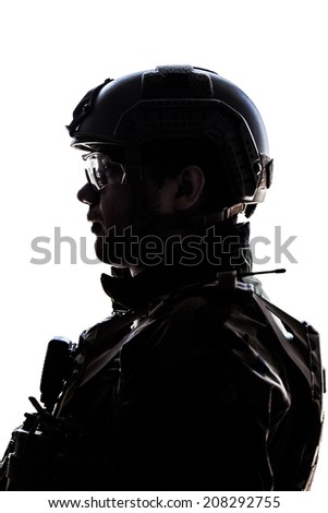 Silhouette of young soldier in military helmet on white background - stock photo