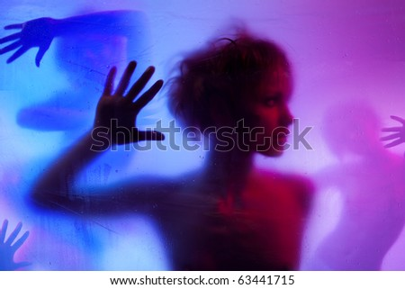 Silhouette  of young woman listening standing behind curtain - stock photo
