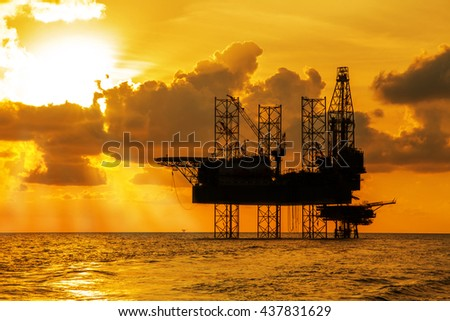 Silhouette, Offshore Jack Up Rig in The Middle of The Sea at Sunset Time