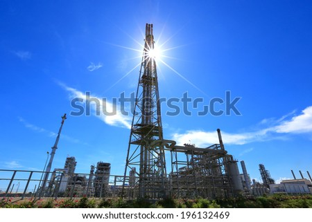 silhouette oil refinery plant against with blue sky  - stock photo