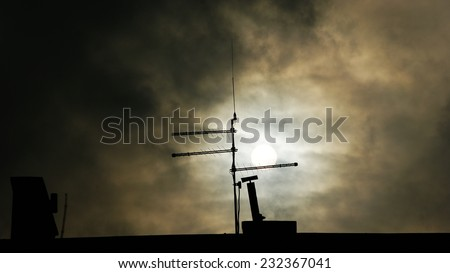 Silhouette on a cloudy sunset background