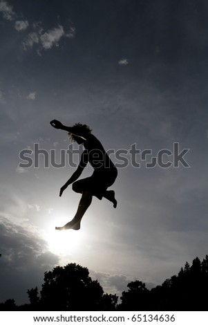 silhouette on trampoline jumping - stock photo