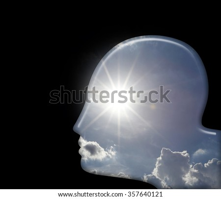 Silhouette outline of a man's head with a sun-burst as eye for the concept of hallucination.  - stock photo