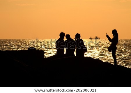 Silhouette people and sunset - stock photo
