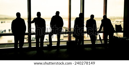 silhouette people at the airport - stock photo