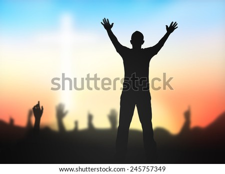Silhouette people raising hands over blurred crown of thorns and the white cross on nature background. - stock photo