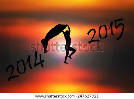 Silhouette person jumping over 2015 on  sunset