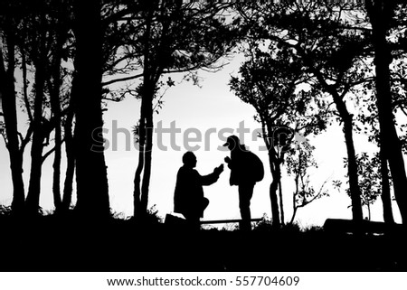silhouette photo of love couple in trees border, back and white tone image.This picture Raw file from camera