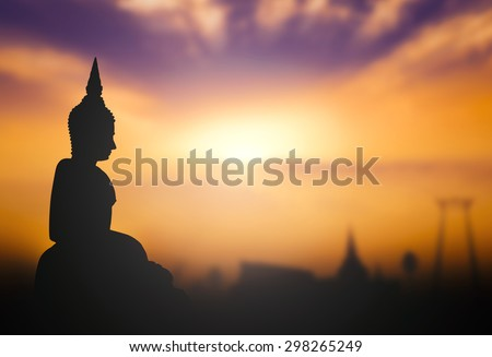 Silhouette public white Buddha, over sunset in Thailand background. Thailand travel concept. End of Buddhist Lent Day concept. - stock photo