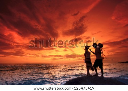 Silhouette romantic Scene of couples on the Beach - stock photo