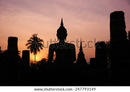 Silhouette ruins temple of Sukhothai historical park - stock photo