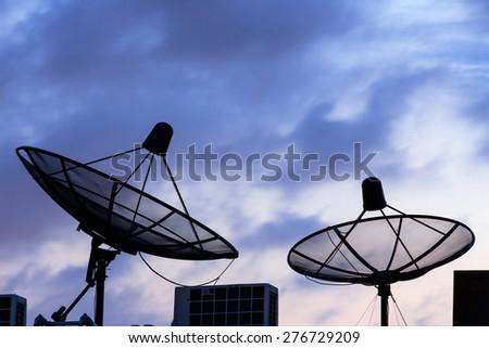 Silhouette 2 Satellite on twilight ,background - stock photo