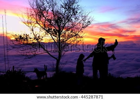 Silhouette sea mist on the mountain ,Reflection light and shadow of cloud and mist on the mountain scenery atmosphere sunset , dark-toned color , Location Phetchabun Province North of Thailand - stock photo