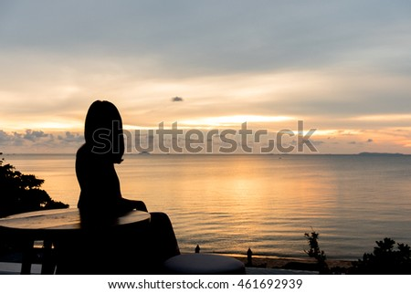 Silhouette shadow of woman look at sunset sunrise on the sea.