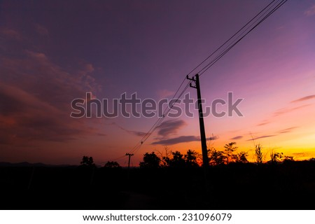 silhouette silhouette electricity post with sky cloud. - stock photo