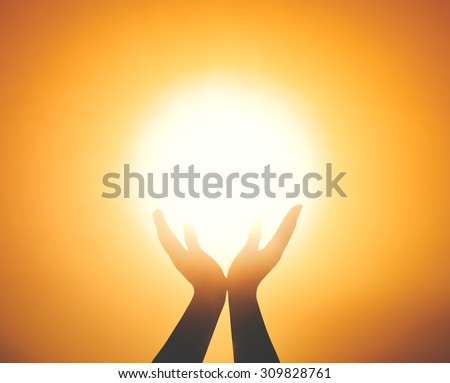 Silhouette spiritual hands or human poverty over blurred sunset background. Hands of pay obeisance over sunrise. Light of the world, World Mental Health, Philosophy, Begging for food or help concept. - stock photo