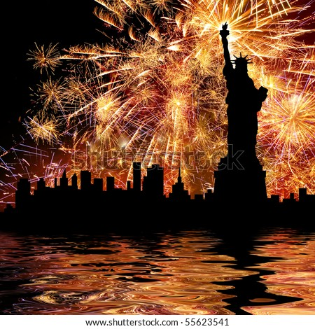 Silhouette statue of liberty on firework background. - stock photo