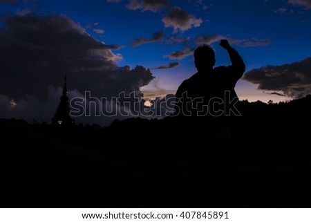 silhouette successful businessman hand fist gesture