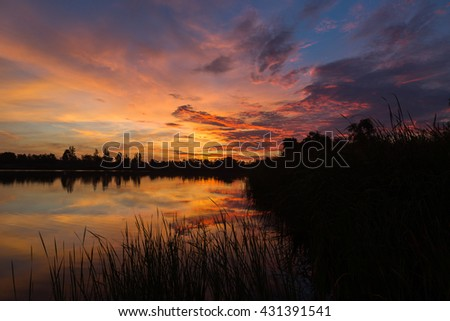 Silhouette sunrise with colorful sky and lake.Silhouette and twilight on morning.Sunrise colorful sky and reflection on the lake.