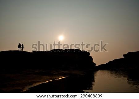 silhouette sunset at rock holes Stone View Sam Pan Bok Grand Canyon, Ubon ratchathani, Northeast of Thailand - stock photo