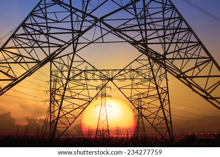 silhouette sunset scene of high voltage electrical pole structure use for electricity generator thermal industry background - stock photo