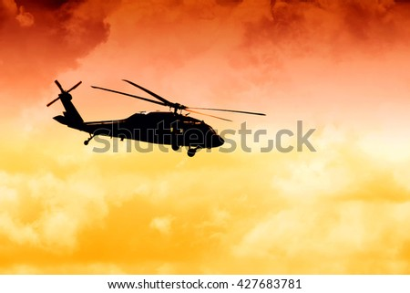 silhouette tansportation helicopter - stock photo