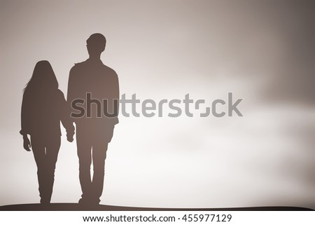 silhouette teenager lovers couple walking on natural background at beach:black shadow loving people holding touching hands:love and valentines concept:matrimonial amour affection wedding anniversary - stock photo