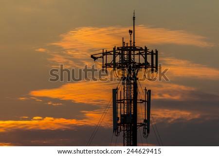 Silhouette Telecommunication tower on sunset  background - stock photo