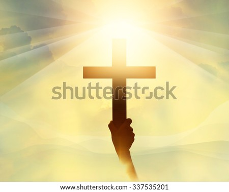 Silhouette the cross in hand, religion symbol in light and landscape over a sunrise, background, religious, faith concept  - stock photo