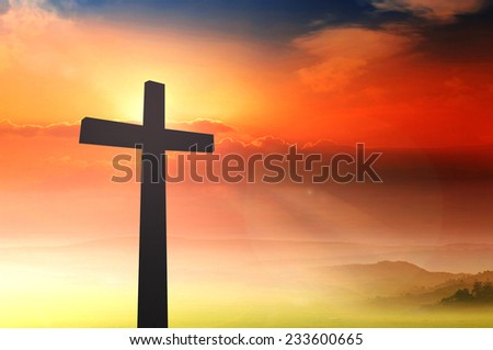 Silhouette the cross over a sunset background. Worship, Forgiveness, Mercy, Humble, Repentance, Reconcile, Adoration, Glorify, Redeemer, Christmas concept.
